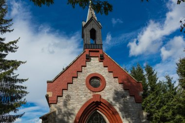 Country church with blue sky in forest