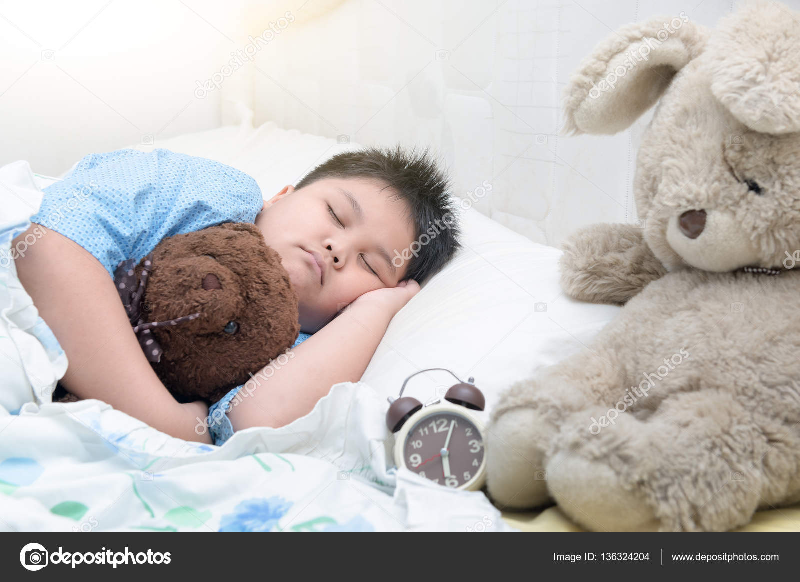 Fat boy sleep on bed in morning stock photo