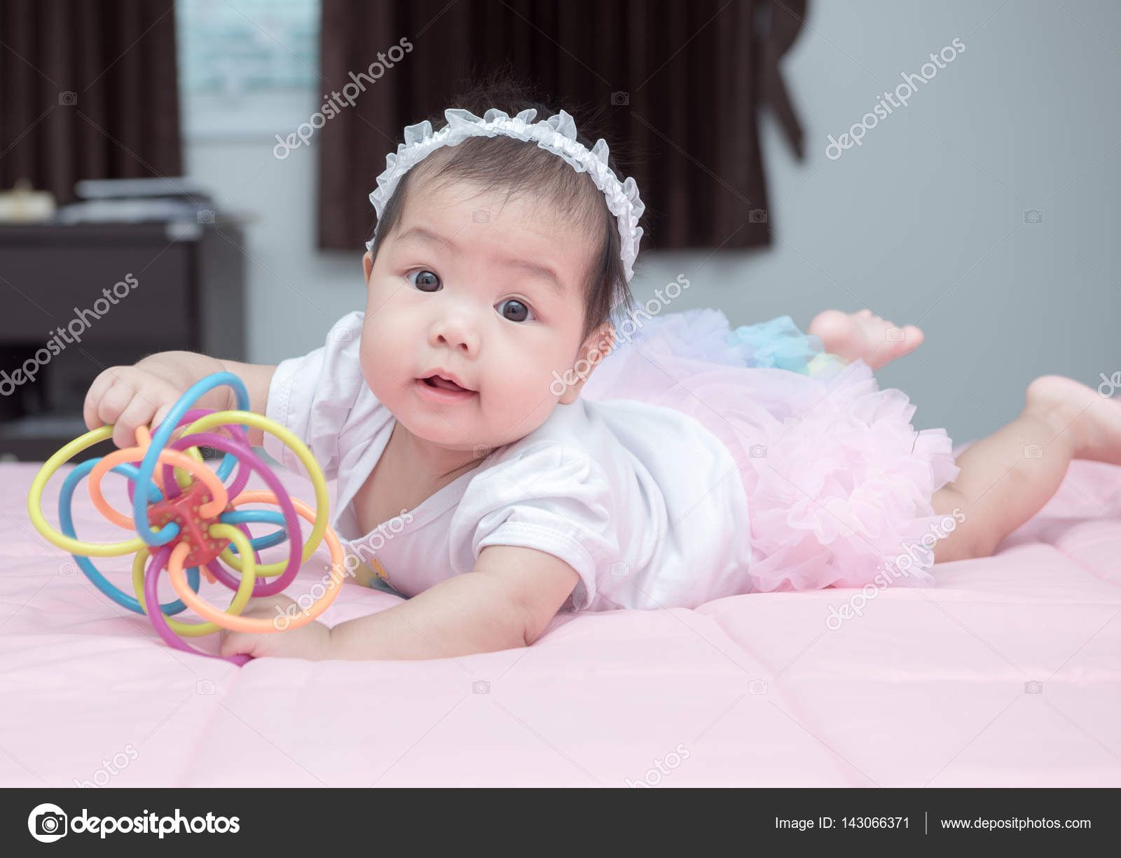 cute baby smile and play toy on pink blanket — stock photo