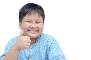 Portrait of asian happy fat boy showing thumbs up gesture.