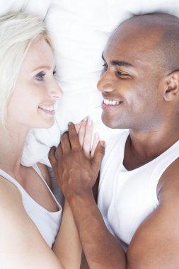 Interracial young couple cuddling