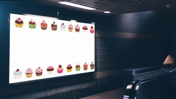 billboard s reklamou na stěně, pohybující se cupcakes na bílé obrazovce