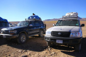 People coming from the Atacama Desert are waiting at the border of Bolivia to continue to Uyuni Salt Flats with off-road vehicles and guides, Bolivia