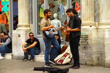 ATHENS, GREECE - 24 April 2015. A music band is playing on the street in Athens.
