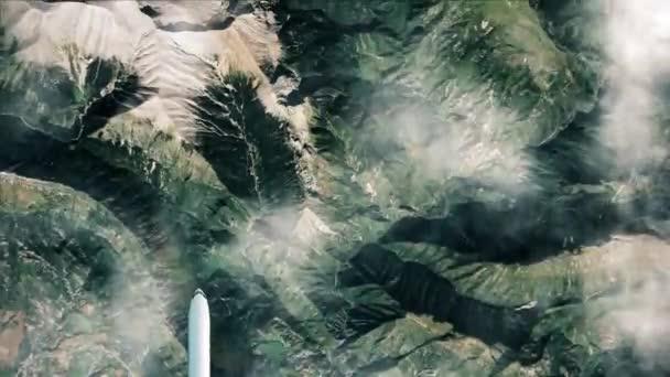 Légi felvétel Maladetáról, Spanyolországról. Átrepülni a hegyeken. Top kilátás a fehér repülőgép repülő hegyek felett.
