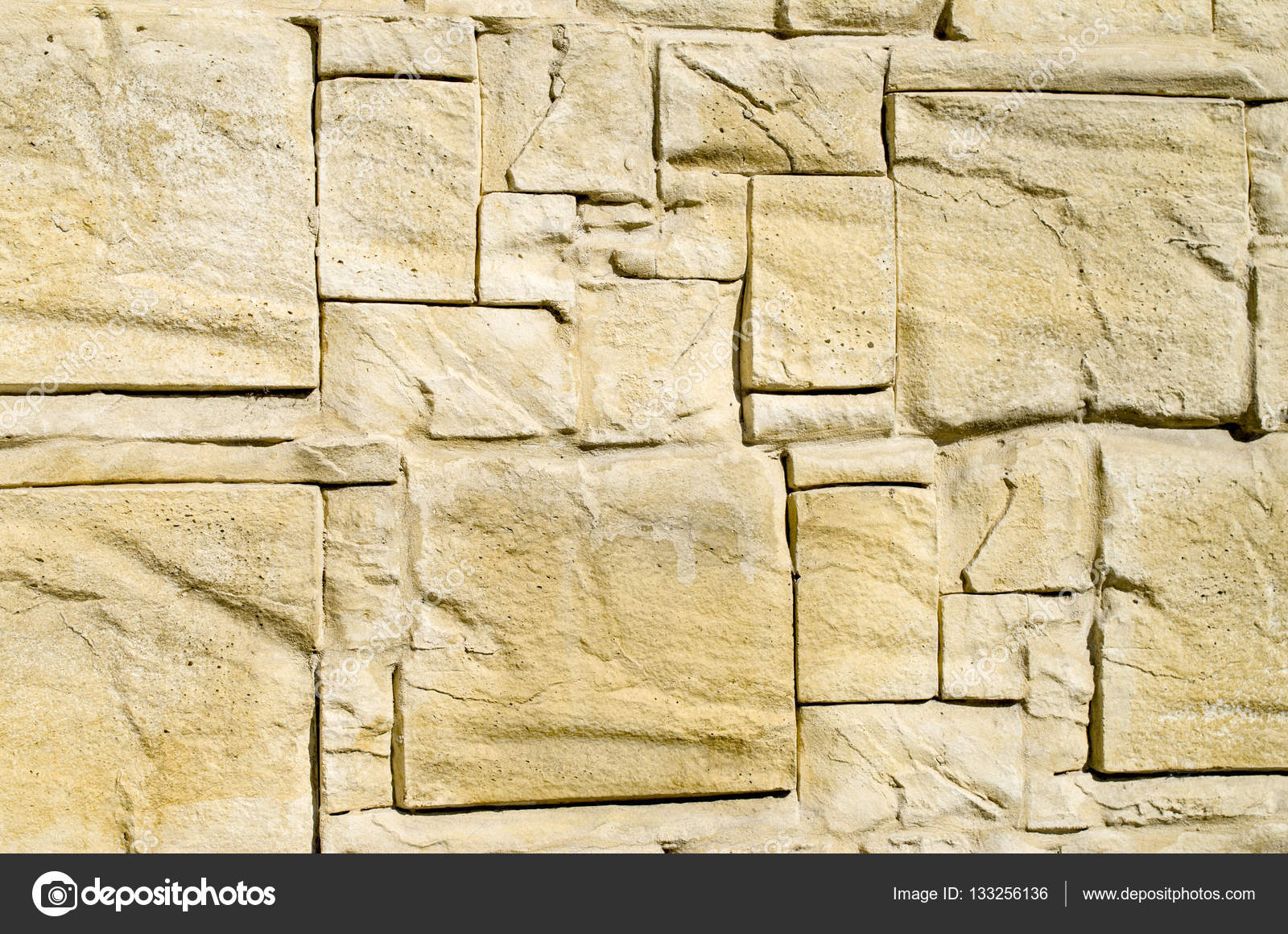 Decorative relief cladding slabs imitating stones on wall — Stock ...