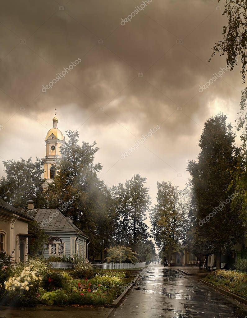 Rain like tears is washing away our sins. The bell tower of the Monastery (Russia) after the rain