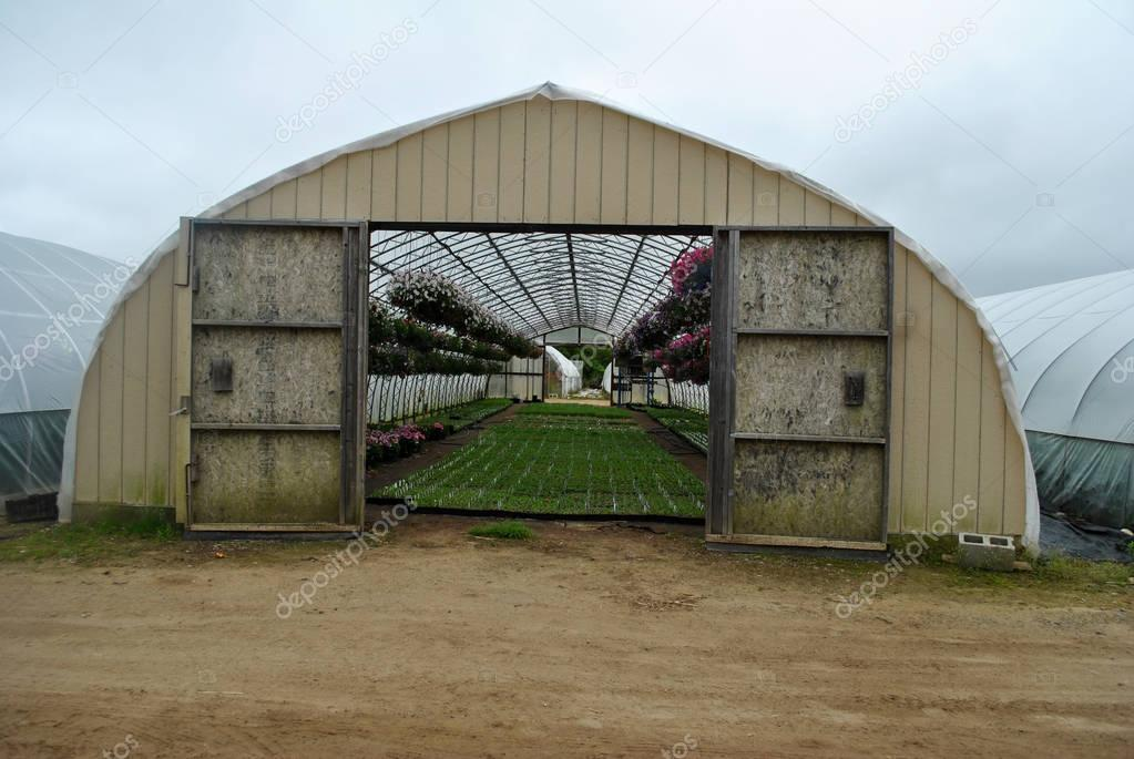 A Large Greenhouse on a Cloudy Spring Day