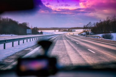 Driving a car on a winter road