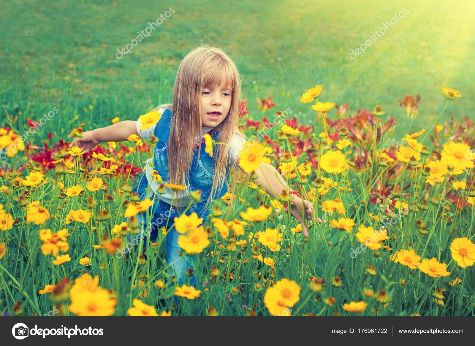 Little Girl Walking Flower Lawn Stock Photo Vvvita 176961722