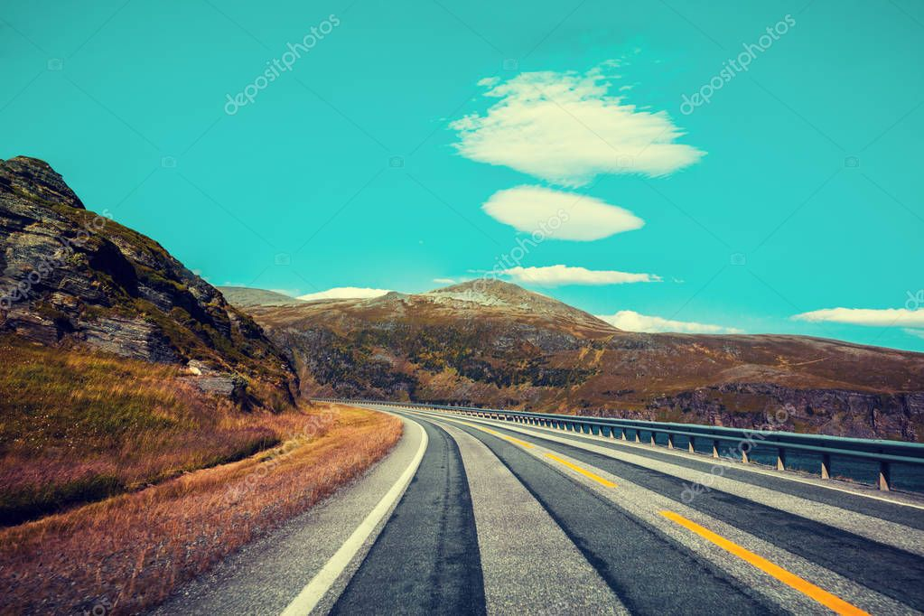 Mountain road along fjord. Stripped way. Nature Norway.