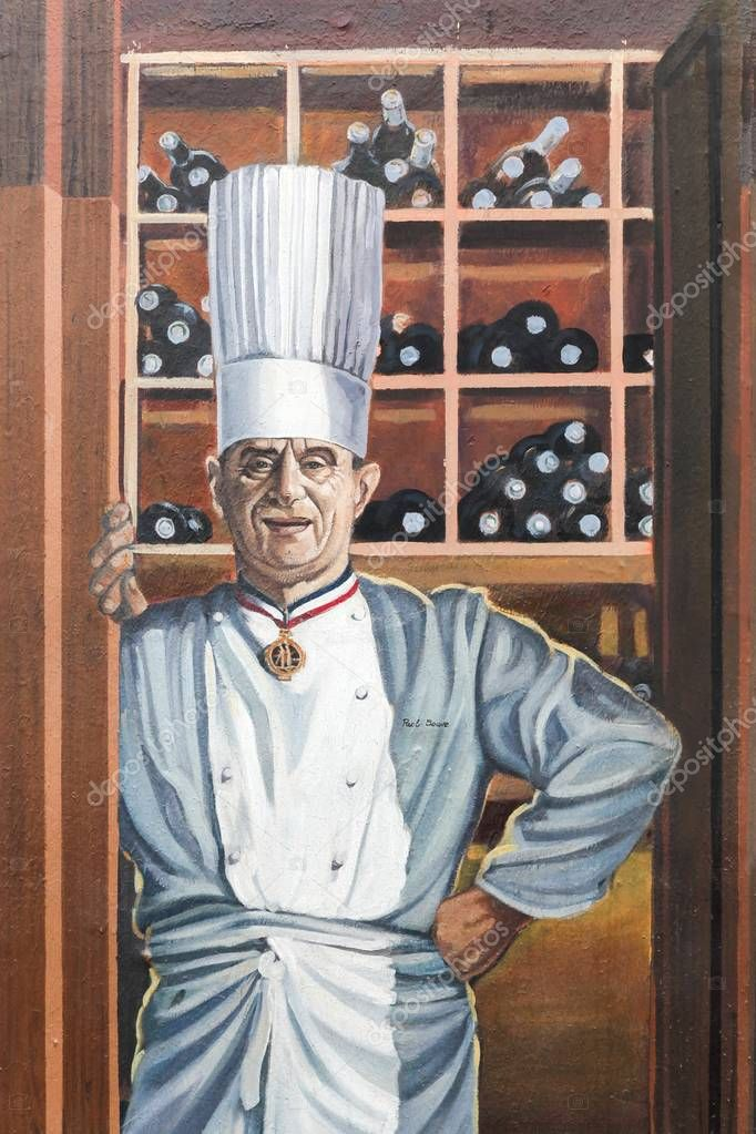 Lyon, France - September 20, 2017: Facade of a building in Lyon with the french and famous chef Paul Bocuse