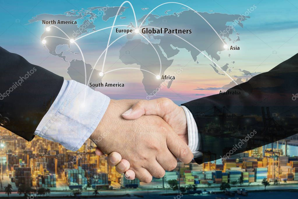 Double Exposure of a businessman handshake  with Map global part