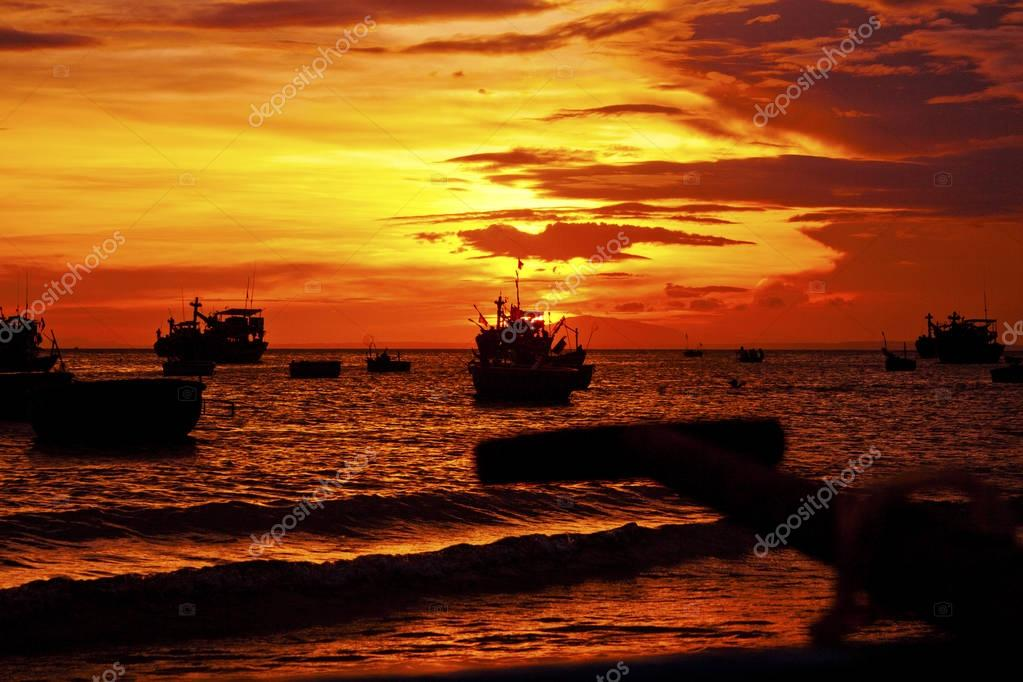 beautiful twilight sky at sunset view of a fishing boat on a sto