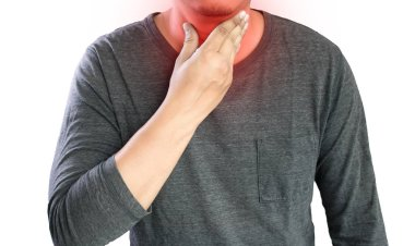 MAN with symptomatic acid reflux , suffering from acid reflux at