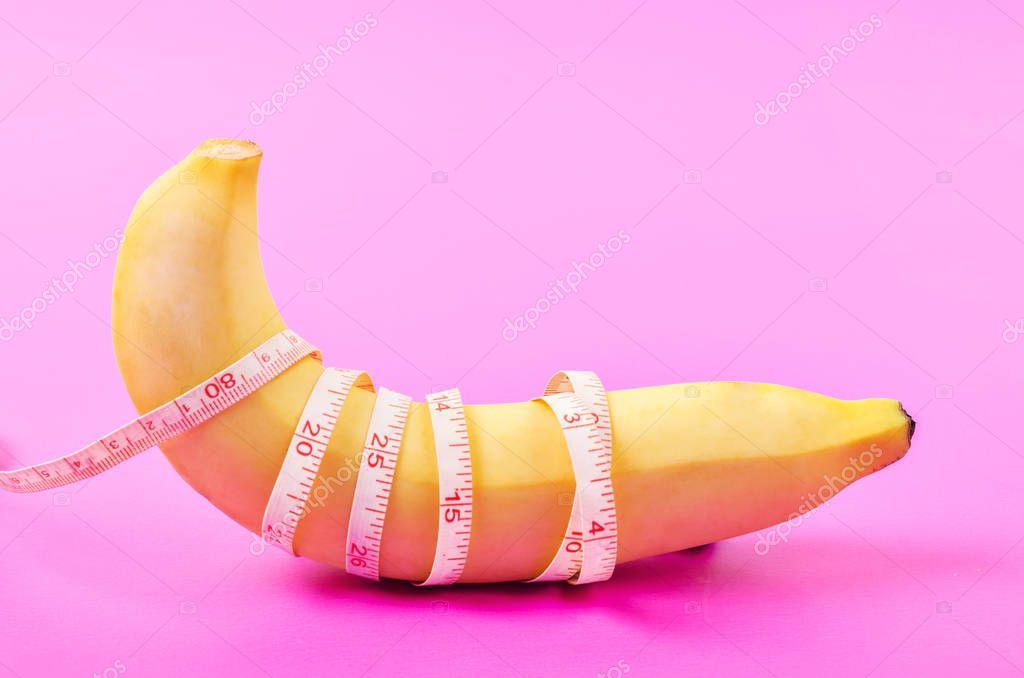 Beautiful banana with measuring tape.