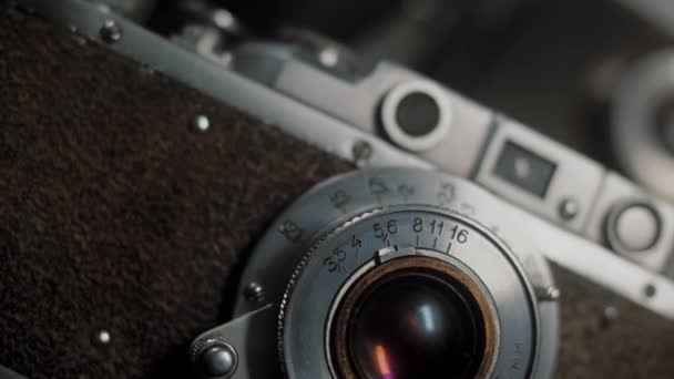 Lens with aperture values of old vintage photo camera, slow rotation movement