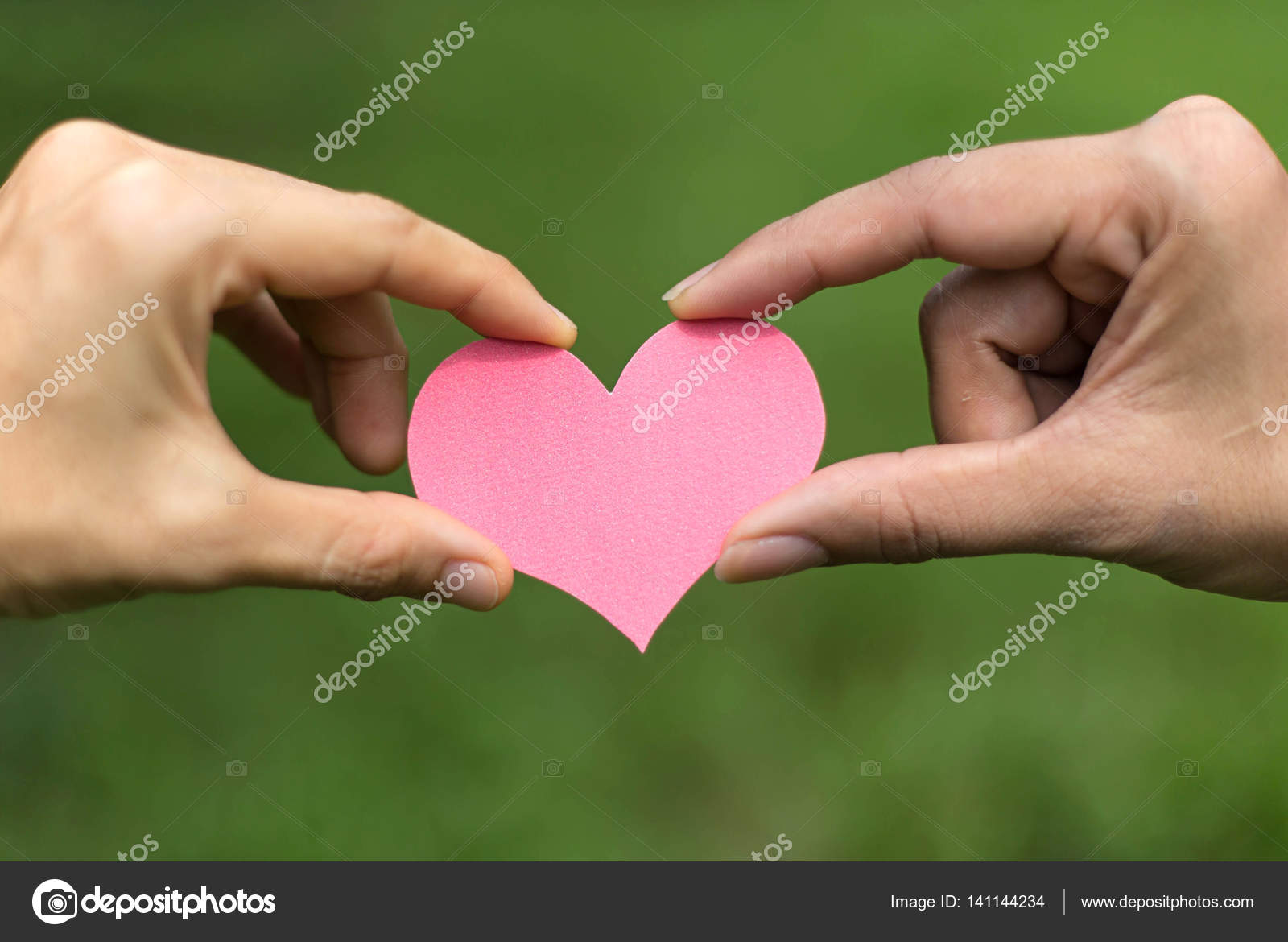 two hands holding a heart