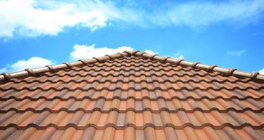 Brown brick roof , blue sky background.