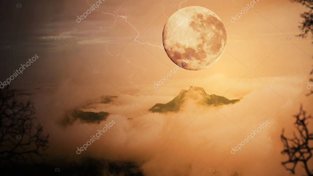 Dramatic sky with tree, full moon, fog and clouds over mountain,