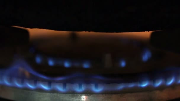 Closeup fire from gas kitchen stove.