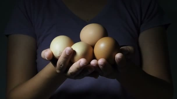 Woman hands with eggs