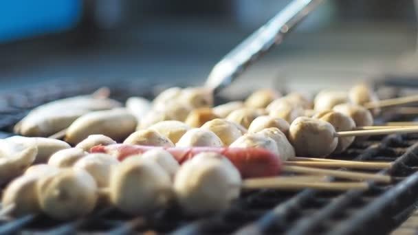Street food, Cooking porkballs sticks on grill.