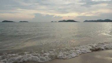 Camera tilt up,Sea waves beach.