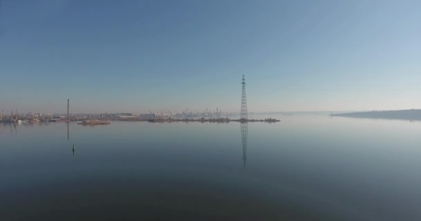 Aerials view from above on expanse of morning river with electric poles