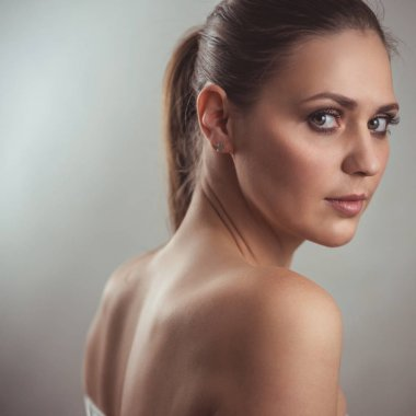Portrait of a beautiful young woman. Female face close up. Makeup