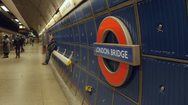 London, United Kingdom - October 20, 2017: Smooth slow motion point of interest camera movement of London Bridge underground sign in London, UK