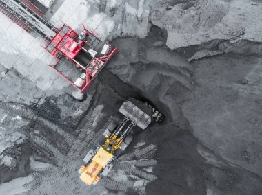 Open pit mine, breed sorting. Mining coal. Bulldozer sorts coal. Extractive industry, anthracite. Coal industry.
