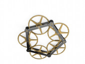 Clockwork mechanism with brass cogs and steel bridge on white background