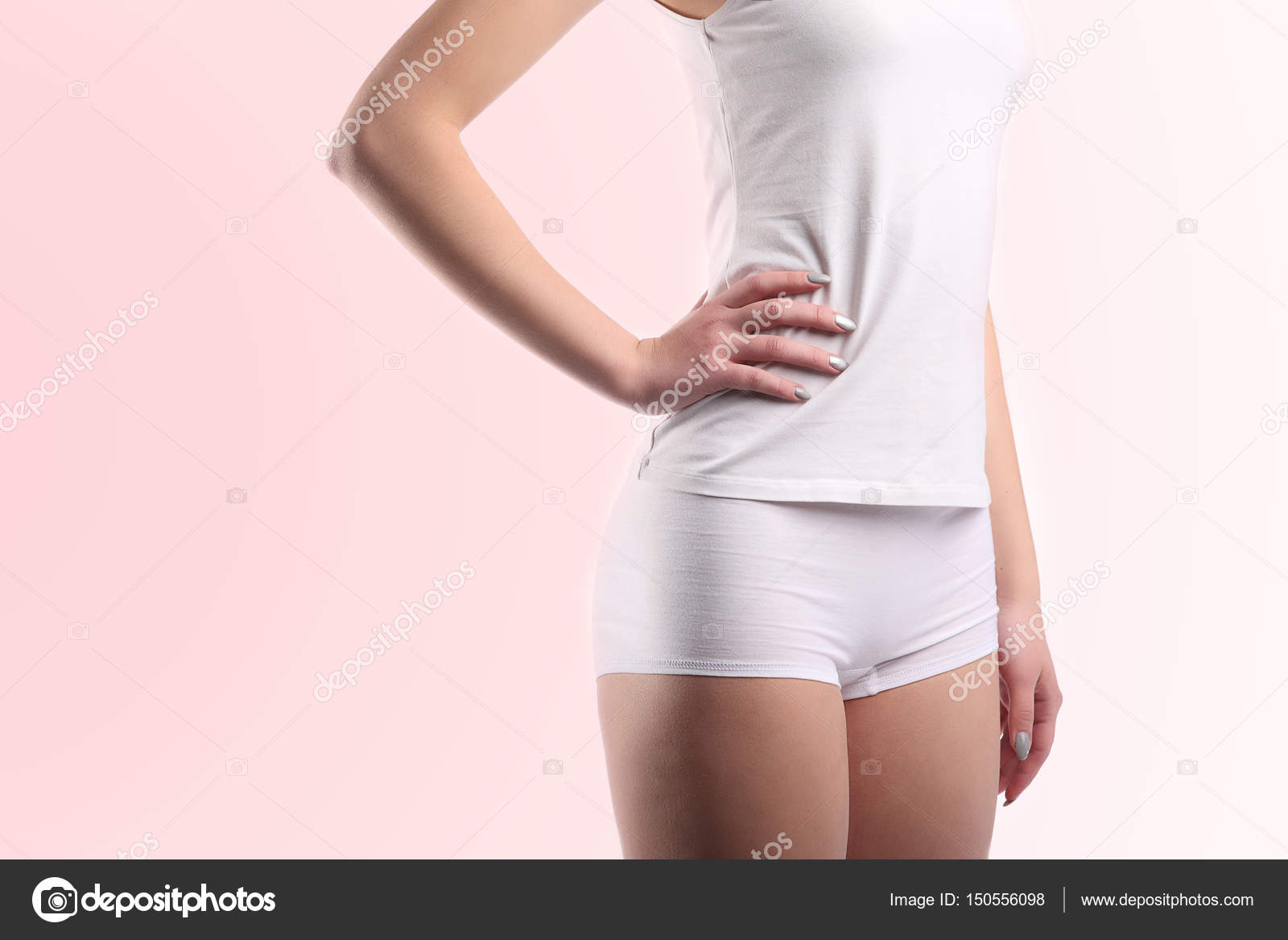 7c4bb3433624 Young woman body with white cotton panties and shirt isolated on pink —  Stock Photo