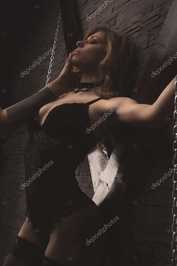 couple play in love games. BDSM. woman in chains