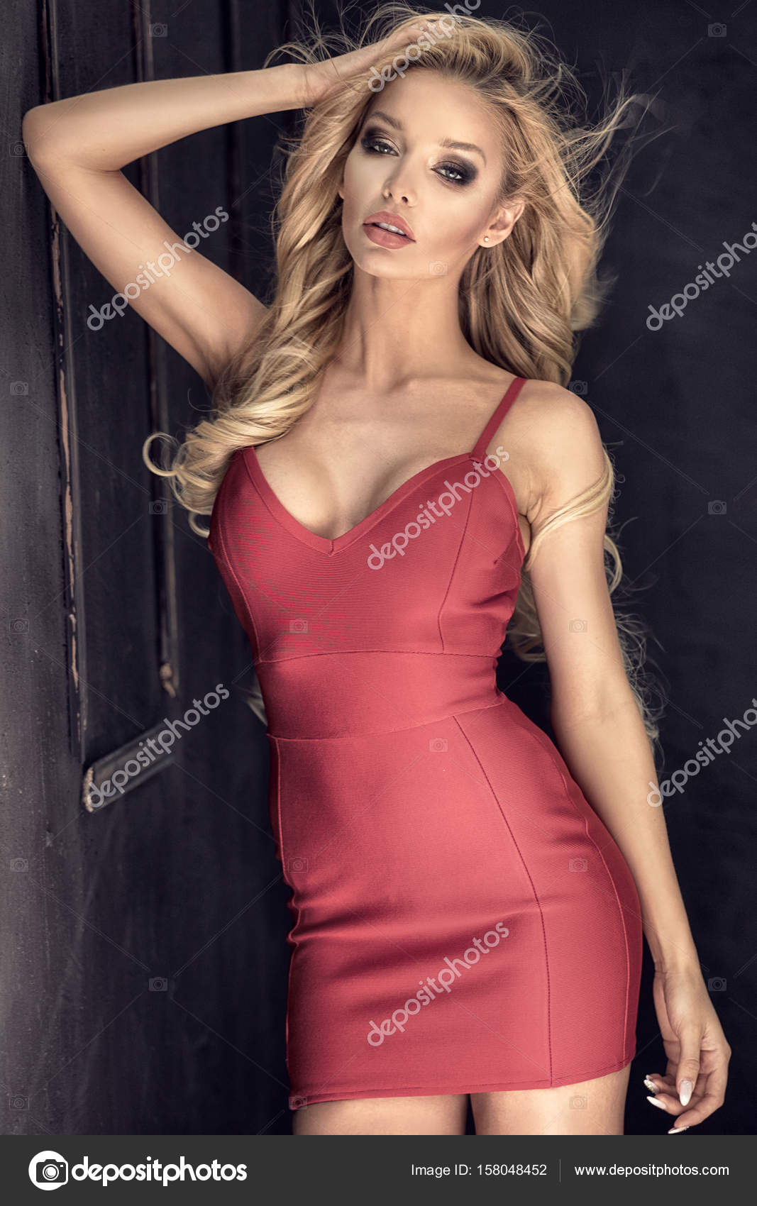 Beautiful blonde woman in red dress. — Stock Photo © NeonShot #158048452