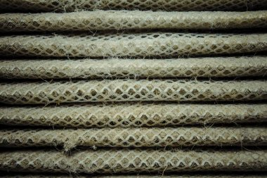 Detailed fragment of dirty air filter surface.