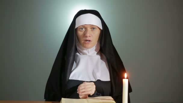Halloween. nun prays. shadows in the form of devil. exorcism