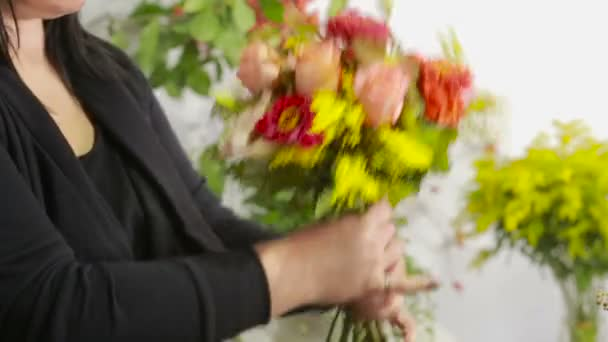 Florist prepares a bouquet of flowers for sale to customers