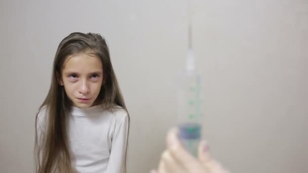 Little girl is afraid of the doctor with a syringe  baby cries afraid  injection