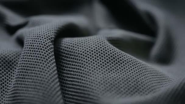 hadřík na OK. černé syntetické tkaniny. lze použít jako pozadí