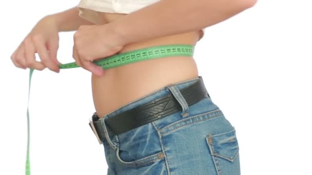 woman measures her belly. woman with the fat on the belly