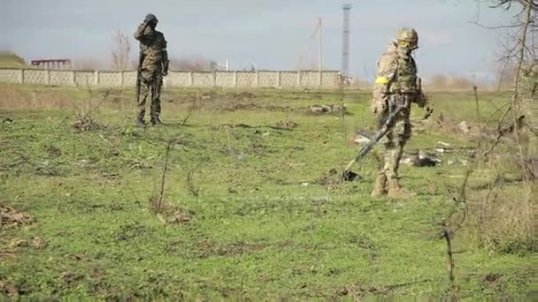 militias are fighting. Men in camouflage with guns and playing airsoft. war