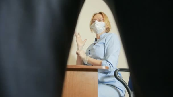 a man is examined by a doctor of the urologist. woman doctor. inspects