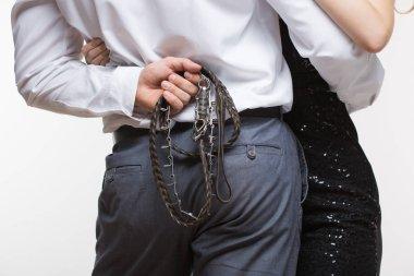 sexy couple. man holding a leash. dog collar