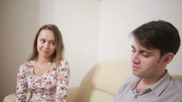 Female psychologist helping worried young couple  family therapy