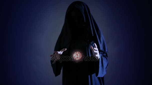 halloween powerful witch or wizard with fireball in hands ball