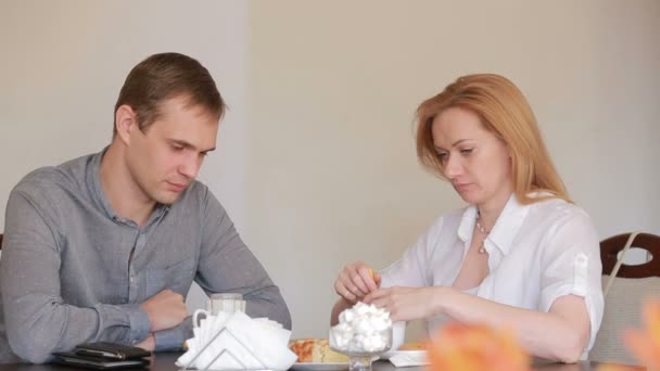 Couple quarrel in a cafe, separation, emotional conversation  Man and woman