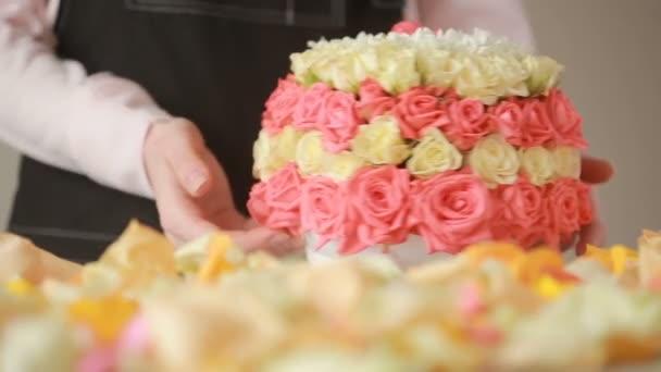 Florist woman gathers a bouquet. gentle big bouquet of peach roses