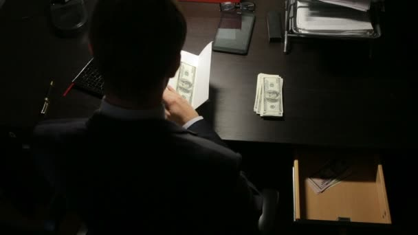 corruption, bribery and fraud concept - close up of businessman taking money